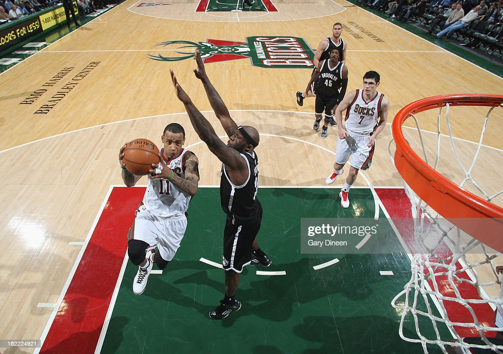 <a gi-track='captionPersonalityLinkClicked' href=/galleries/search?phrase=Monta+Ellis&family=editorial&specificpeople=567403 ng-click='$event.stopPropagation()'>Monta Ellis</a> #11 of the Milwaukee Bucks shoots against <a gi-track='captionPersonalityLinkClicked' href=/galleries/search?phrase=Reggie+Evans&family=editorial&specificpeople=202254 ng-click='$event.stopPropagation()'>Reggie Evans</a> #30 of the Brooklyn Nets on February 20, 2013 at the BMO Harris Bradley Center in Milwaukee, Wisconsin.