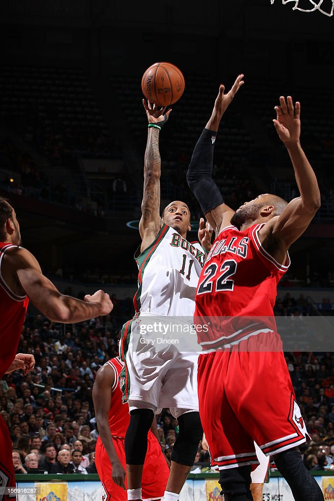Monta Ellis #11 of the Milwaukee Bucks shoots against Taj Gibson #22 of the Chicago Bulls during the NBA game on November 24, 2012 at the BMO Harris Bradley Center in Milwaukee, Wisconsin.