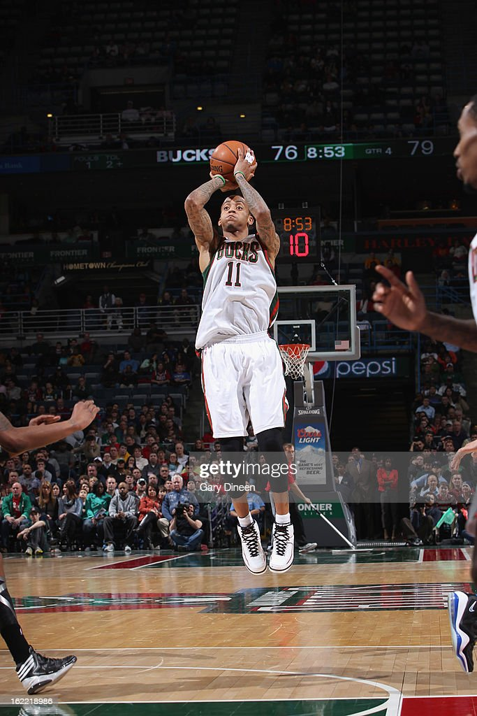 <a gi-track='captionPersonalityLinkClicked' href=/galleries/search?phrase=Monta+Ellis&family=editorial&specificpeople=567403 ng-click='$event.stopPropagation()'>Monta Ellis</a> #11 of the Milwaukee Bucks shoots against the Brooklyn Nets on February 20, 2013 at the BMO Harris Bradley Center in Milwaukee, Wisconsin.
