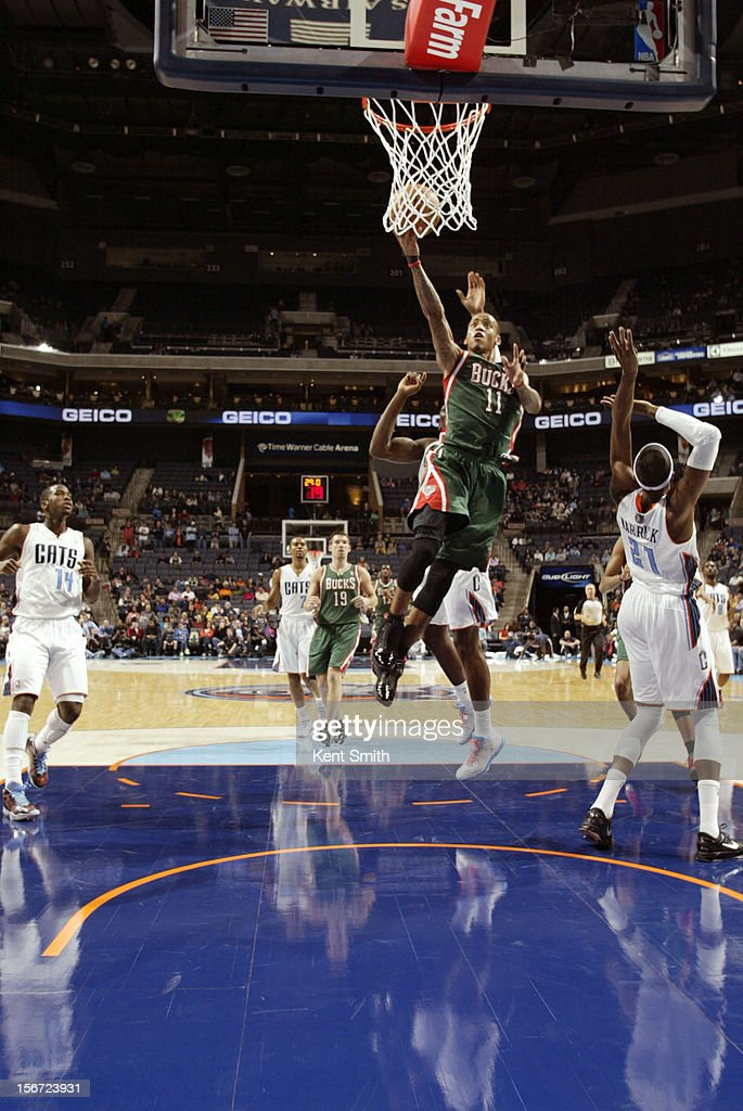 <a gi-track='captionPersonalityLinkClicked' href=/galleries/search?phrase=Monta+Ellis&family=editorial&specificpeople=567403 ng-click='$event.stopPropagation()'>Monta Ellis</a> #11 of the Milwaukee Bucks shoots against the Charlotte Bobcats at the Time Warner Cable Arena on November 19, 2012 in Charlotte, North Carolina.
