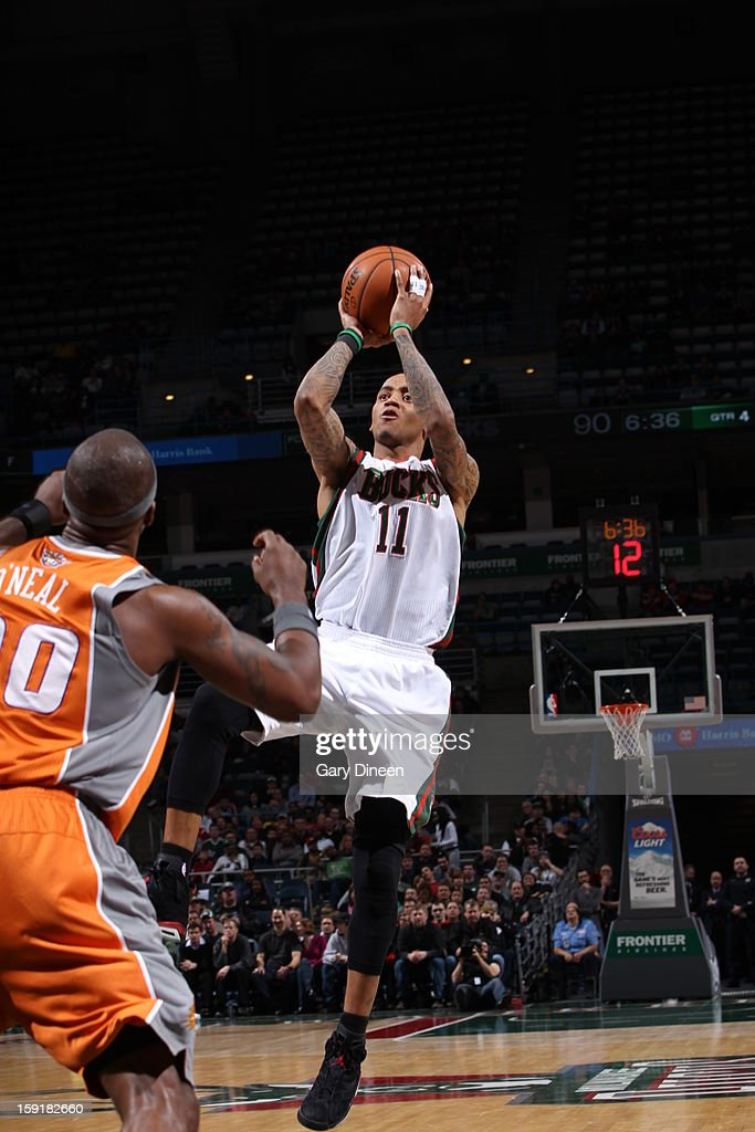 <a gi-track='captionPersonalityLinkClicked' href=/galleries/search?phrase=Monta+Ellis&family=editorial&specificpeople=567403 ng-click='$event.stopPropagation()'>Monta Ellis</a> #11 of the Milwaukee Bucks shoots against the Phoenix Suns on January 8, 2013 at the BMO Harris Bradley Center in Milwaukee, Wisconsin.