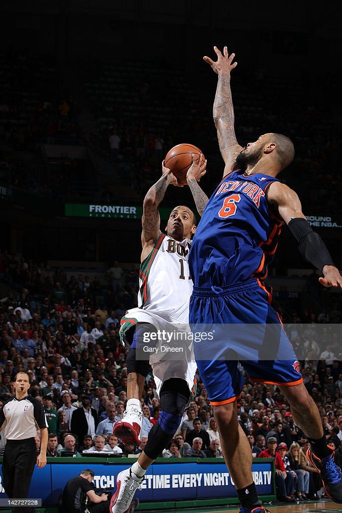 <a gi-track='captionPersonalityLinkClicked' href=/galleries/search?phrase=Monta+Ellis&family=editorial&specificpeople=567403 ng-click='$event.stopPropagation()'>Monta Ellis</a> #11 of the Milwaukee Bucks shoots against <a gi-track='captionPersonalityLinkClicked' href=/galleries/search?phrase=Tyson+Chandler&family=editorial&specificpeople=202061 ng-click='$event.stopPropagation()'>Tyson Chandler</a> #6 of the New York Knicks on April 11, 2012 at the Bradley Center in Milwaukee, Wisconsin.