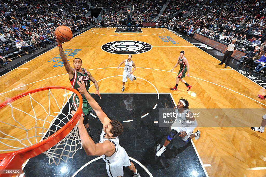 Monta Ellis #11 of the Milwaukee Bucks shoots the ball against Kris Humphries #43 of the Brooklyn Nets during the game at the Barclays Center on December 9, 2012 in Brooklyn, New York.