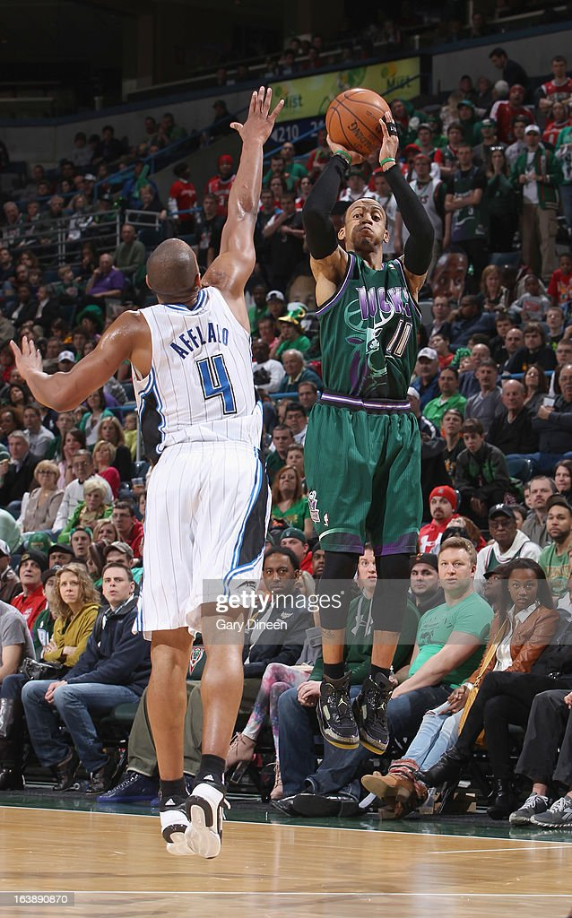 <a gi-track='captionPersonalityLinkClicked' href=/galleries/search?phrase=Monta+Ellis&family=editorial&specificpeople=567403 ng-click='$event.stopPropagation()'>Monta Ellis</a> #11 of the Milwaukee Bucks shotos a three-pointer against <a gi-track='captionPersonalityLinkClicked' href=/galleries/search?phrase=Arron+Afflalo&family=editorial&specificpeople=640861 ng-click='$event.stopPropagation()'>Arron Afflalo</a> #4 of the Orlando Magic on March 17, 2013 at the BMO Harris Bradley Center in Milwaukee, Wisconsin.