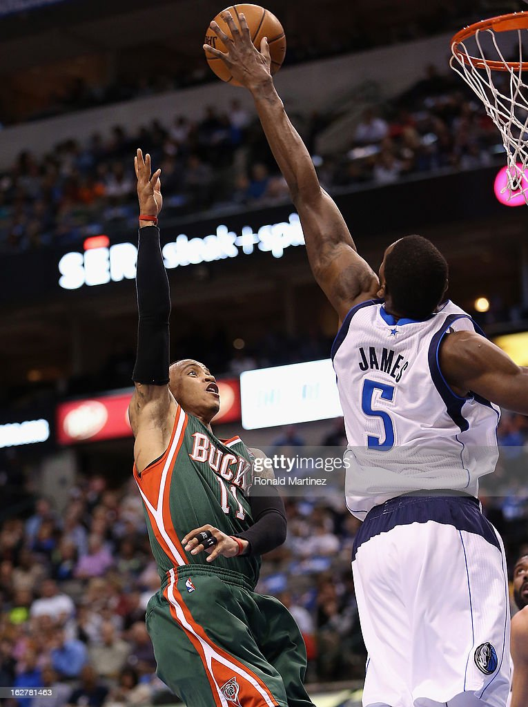 Monta Ellis #11 of the Milwaukee Bucks takes a shot against Bernard James #5 of the Dallas Mavericks at American Airlines Center on February 26, 2013 in Dallas, Texas.