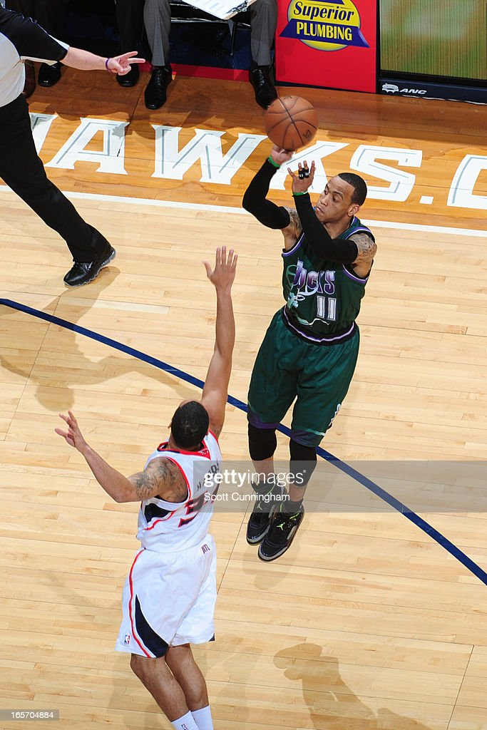 <a gi-track='captionPersonalityLinkClicked' href=/galleries/search?phrase=Monta+Ellis&family=editorial&specificpeople=567403 ng-click='$event.stopPropagation()'>Monta Ellis</a> #11 of the Milwaukee Bucks takes a shot against the Atlanta Hawks on March 20, 2013 at Philips Arena in Atlanta, Georgia.