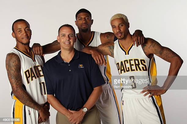 Monta Ellis Paul George and Frank Vogel and George Hill of the Indiana Pacers pose for a portrait during the Indiana Pacers media day at Bankers Life...