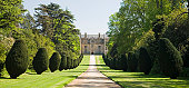 Montacute House showing the elaborate driveway and trees, Somerset, England