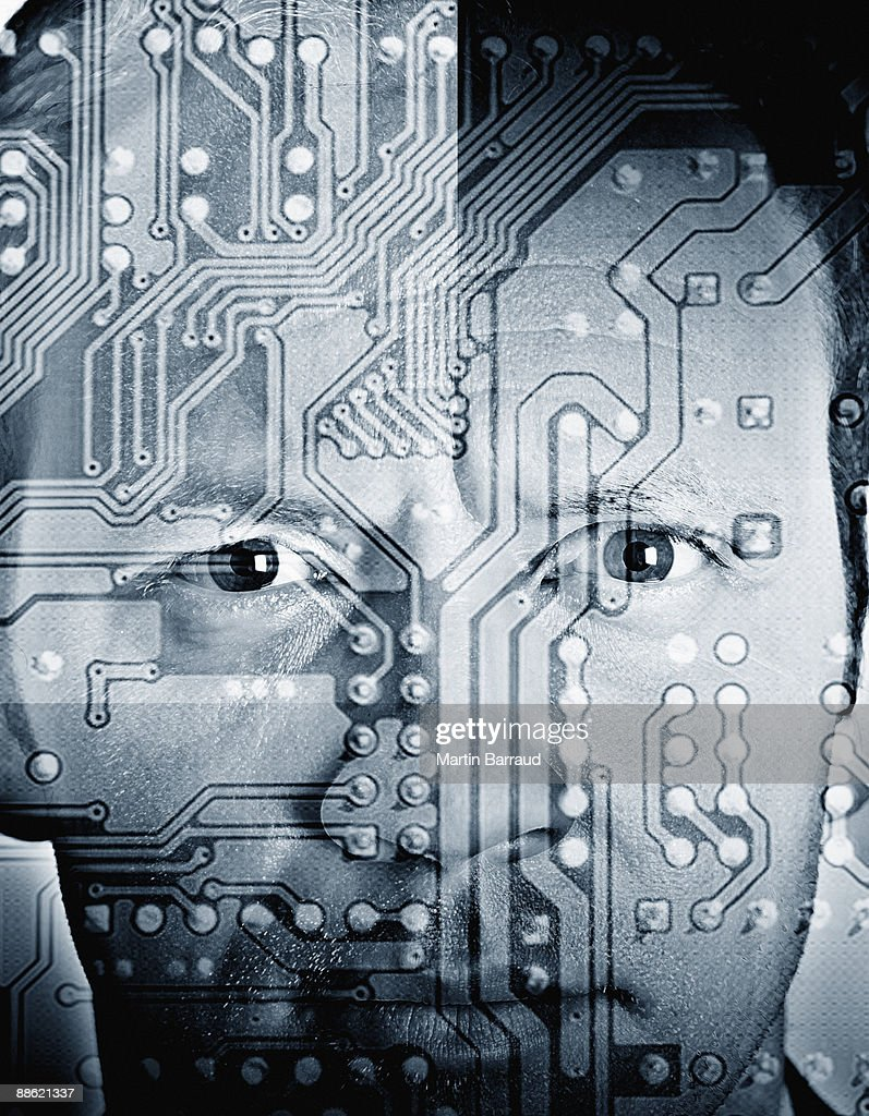 Montage of mans face and microchip : Stock Photo
