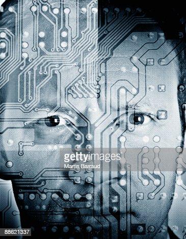 Montage of mans face and microchip : Bildbanksbilder