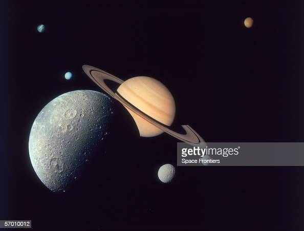A montage of Saturn and its moons Dione Tethys and Mimas Enceladus and Rhea and Titan as depicted by the Voyager 1 spacecraft November 1980