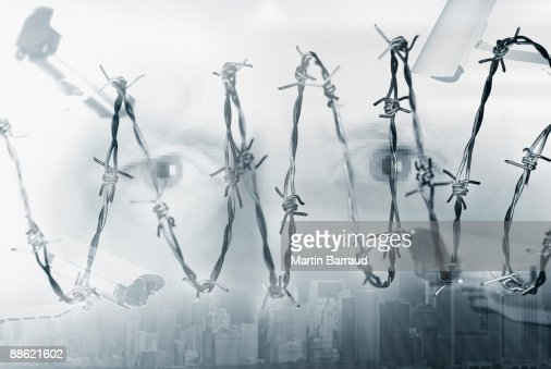 Montage of security cameras, eyes and barbed wire : Stock Photo