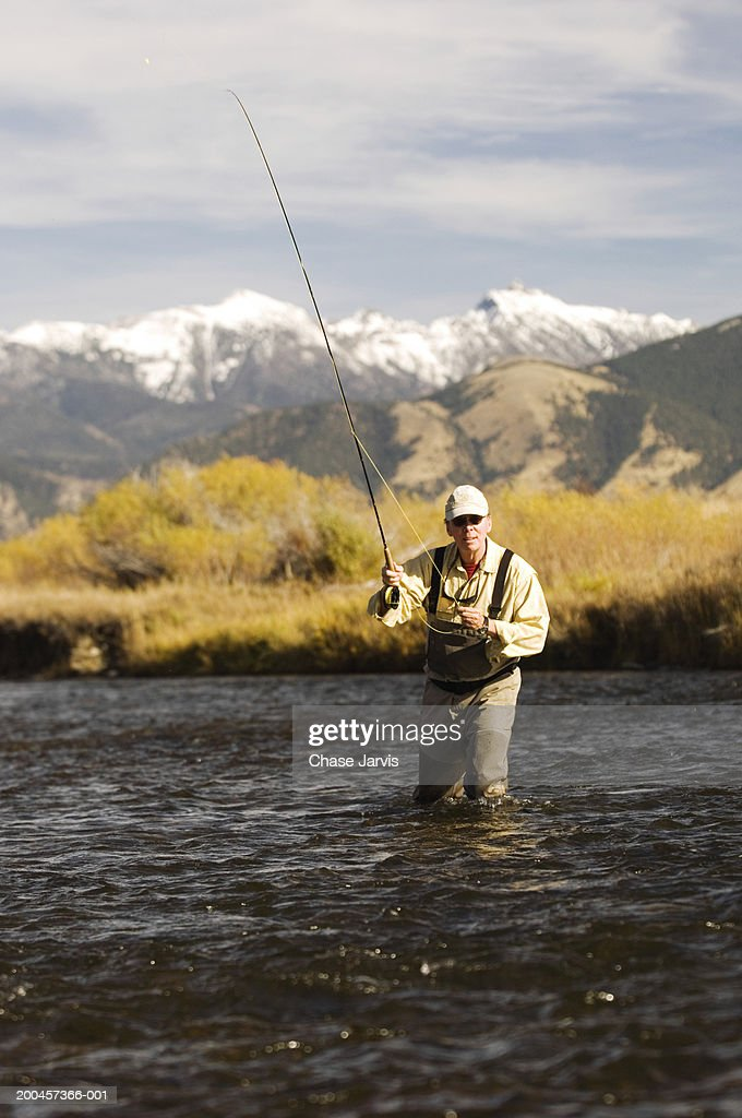 Usa montana alder man flyfishing in ruby river stock photo for Fly fishing photography