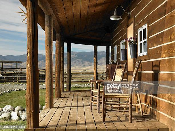 USA, Montana, Bozeman, chairs on porch of cabin