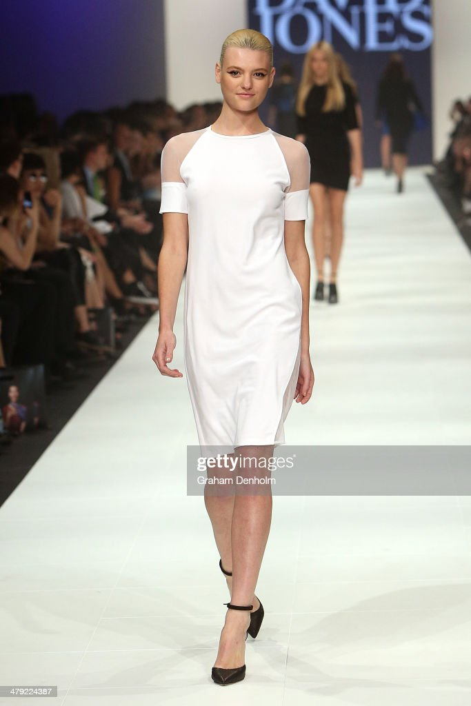 Montana Cox showcases designs by Christopher Esber on the runway during the 2014 Virgin Australia Melbourne Fashion Festival Opening Event presented by David Jones at Docklands on March 17, 2014 in Melbourne, Australia.
