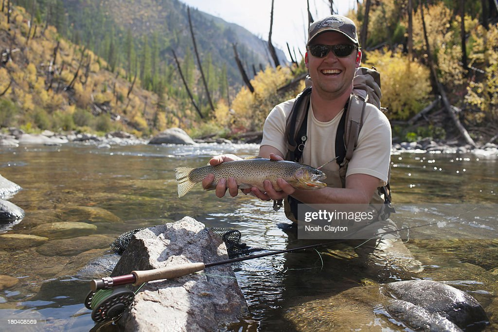 USA, Montana, North Fork, Blackfoot River, Fisherman showing fresh trout