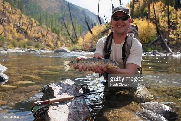 USA, Montana, North Fork, Blackfoot River, Fisherman showing fresh trout