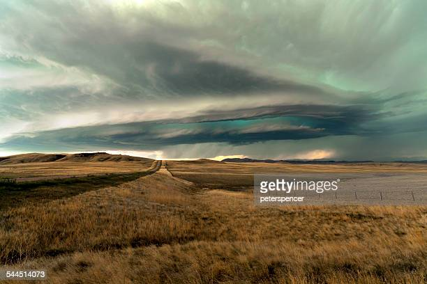 USA, Montana, Storm clouds above field