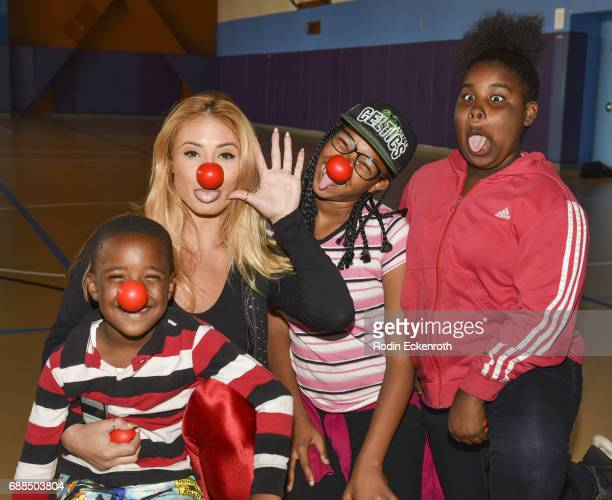 Montana Tucker poses for portrait with children during Red Nose Day at Union Rescue Mission on May 25 2017 in Los Angeles California