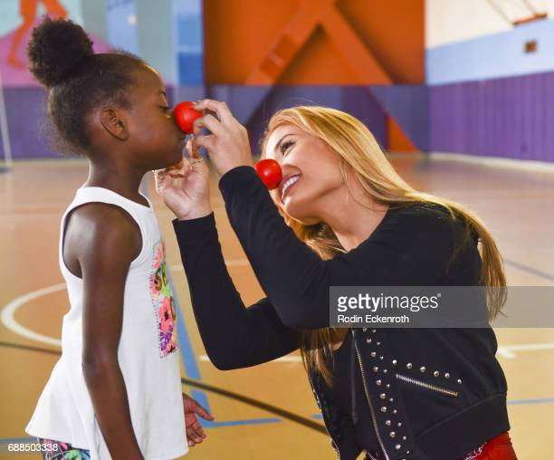 Montana Tucker with kids during Red Nose Day at Union Rescue Mission on May 25 2017 in Los Angeles California