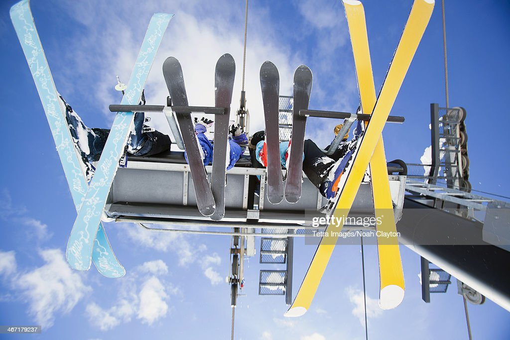 USA, Montana, Whitefish, Family of skiers on ski lift seen from below : Stock Photo