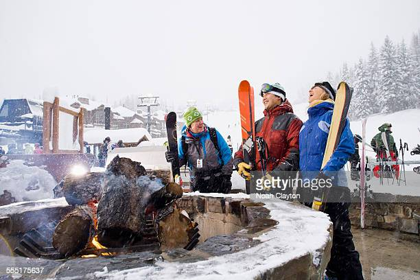 USA, Montana, Whitefish, Group of friends with bonfire in winter