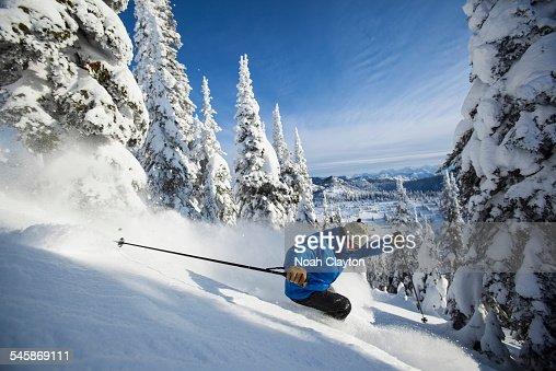 USA, Montana, Whitefish, Man skiing in mountains