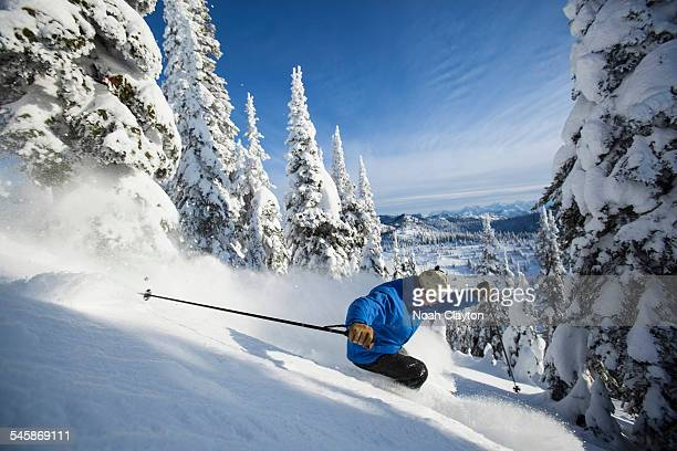 USA, Montana, Whitefish, Man skiing in mountains