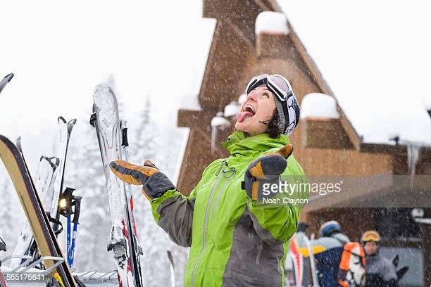 USA, Montana, Whitefish, Portrait of woman enjoying snow