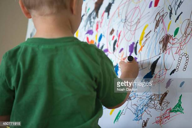 USA, Montana, Whitefish, Toddler drawing on wall