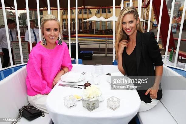 Montarna McDonald and Nikki Phillips pose inside a ferris wheel cabin during Luna Park's 2014 Valentine's event at Luna Park on February 12 2014 in...