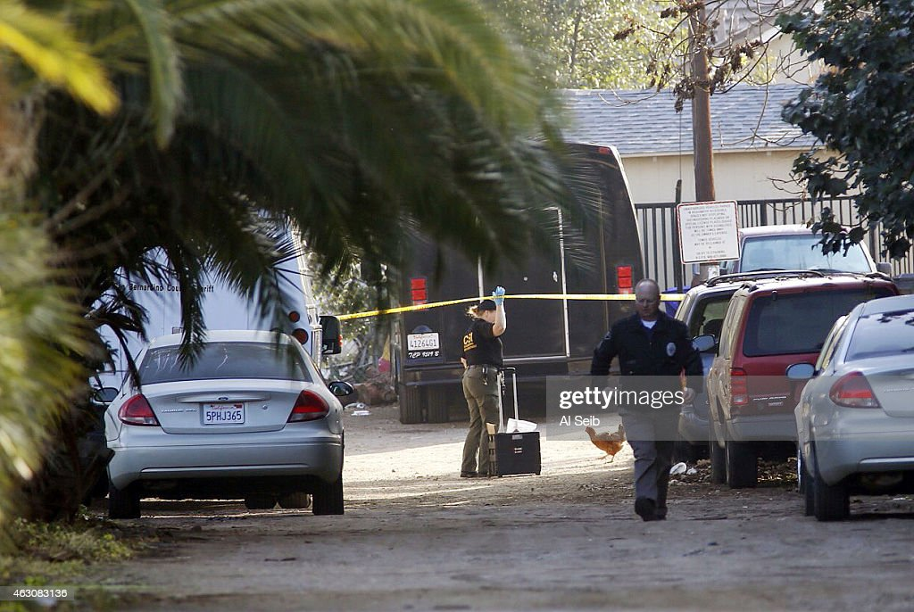 Montclair police homicide detectives search for evidence along a long driveway Monday morning February 9 where two men were found dead Sunday night...