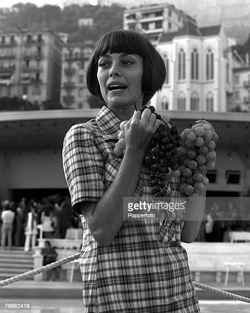 Monte Carlo France 7th September 1970 French singer Mireille Mathieu is pictured holding bunches of grapes in the South of France