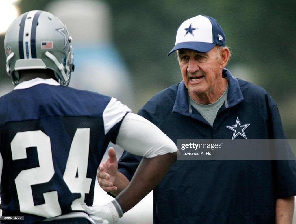 Monte Kiffin Dallas Cowboys' new Defensive Coordinator working with Morris Claiborne corner back in Cowboys' training camp in Oxnard on Jul 21 2013...