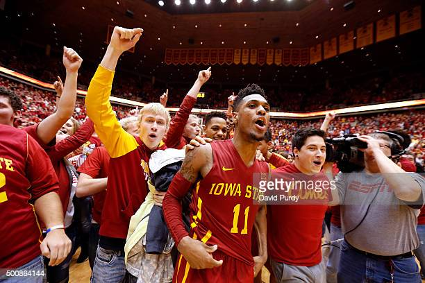 Monte Morris of the Iowa State Cyclones celebrates with fans after he sank the winning basket to defeat the Iowa Hawkeyes 8382 at Hilton Coliseum on...