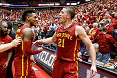 Monte Morris of the Iowa State Cyclones celebrates with teammate Matt Thomas of the Iowa State Cyclones after Morris sank the winning basket to...