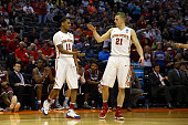 Monte Morris of the Iowa State Cyclones celebrates with teammate Matt Thomas in the first half against the Arkansas Little Rock Trojans during the...