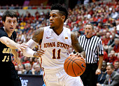 Monte Morris of the Iowa State Cyclones drives the ball as Trent Whiting of the ArkansasPine Bluff Golden Lions blocks in the second half of play at...