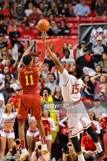 Monte Morris of the Iowa State Cyclones shoots the ball over Aaron Ross during the game on February 20 2017 at United Supermarkets Arena in Lubbock...