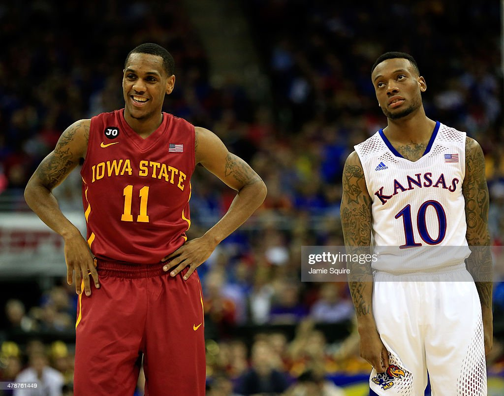 Monte Morris #11 of the Iowa State Cyclones smiles as he stands next to a dejected <a gi-track='captionPersonalityLinkClicked' href=/galleries/search?phrase=Naadir+Tharpe&family=editorial&specificpeople=8624195 ng-click='$event.stopPropagation()'>Naadir Tharpe</a> #10 of the Kansas Jayhawks during the Big 12 Basketball Tournament semifinal game at Sprint Center on March 14, 2014 in Kansas City, Missouri.
