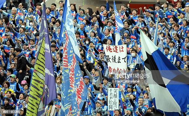 Montedio Yamagata supporters cheer during the JLeague match between Urawa Red Diamonds and Montedio Yamagata at Saitama Stadium on March 14 2015 in...