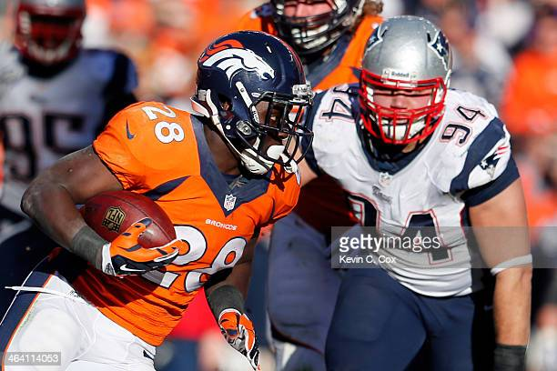 Montee Ball of the Denver Broncos breaks a tackle against Chris Jones of the New England Patriots during the AFC Championship game at Sports...
