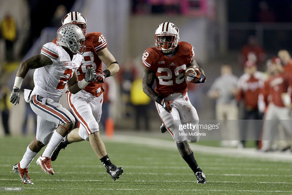 Montee Ball #28 of the Ohio State Buckeyes runs the ball upfield during the game against the Wisconsin Badgers at Camp Randall Stadium on November 17, 2012 in Madison, Wisconsin.