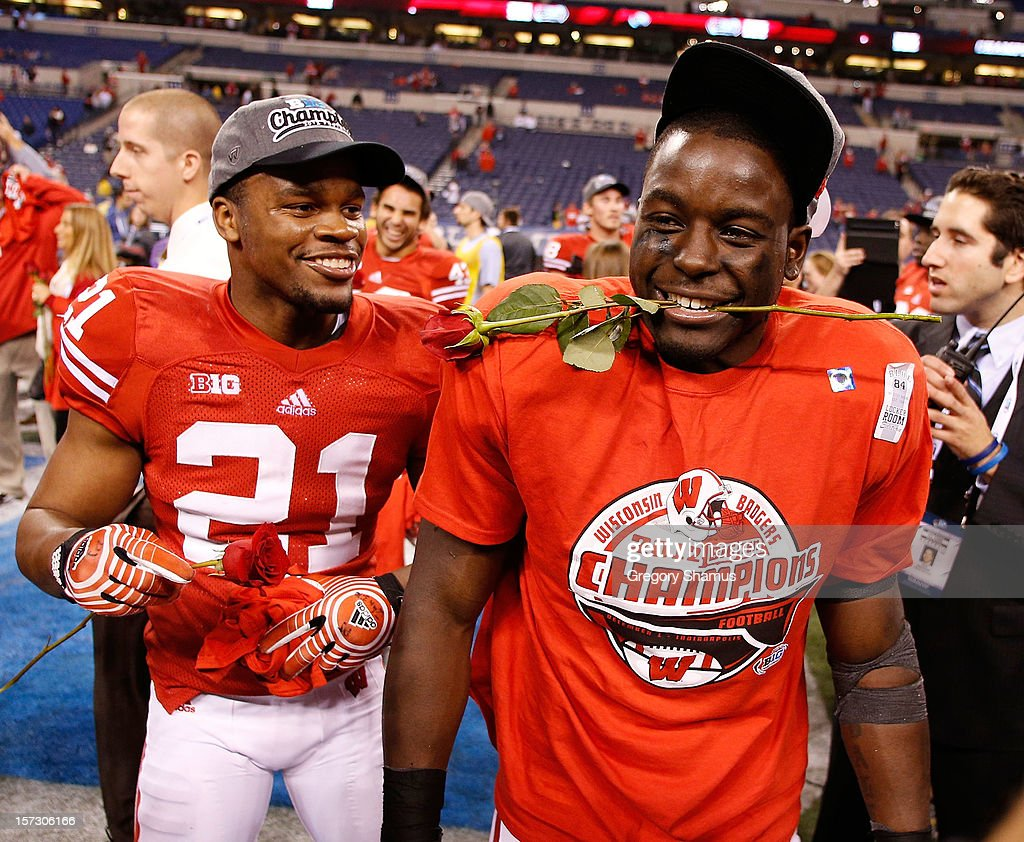 Montee Ball #28 of the Wisconsin Badgers celebrates a 70-31 win over the Nebraska Cornhuskers with Peniel Jean #21after the Big 10 Conference Championship Game at Lucas Oil Stadium on December 1, 2012 in Indianapolis, Indiana.