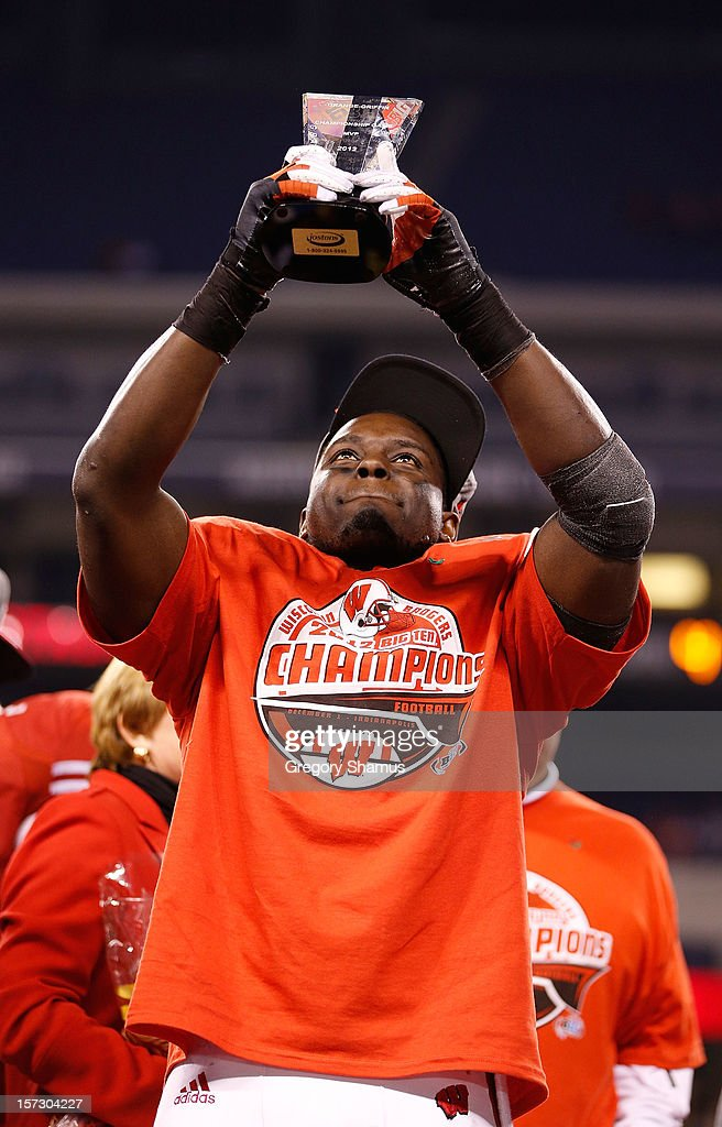 Montee Ball #28 of the Wisconsin Badgers holds up the Grange-Griffin Most Valuable Player Award after defeating the Nebraska Cornhuskers 70-31in the Big 10 Conference Championship Game at Lucas Oil Stadium on December 1, 2012 in Indianapolis, Indiana.