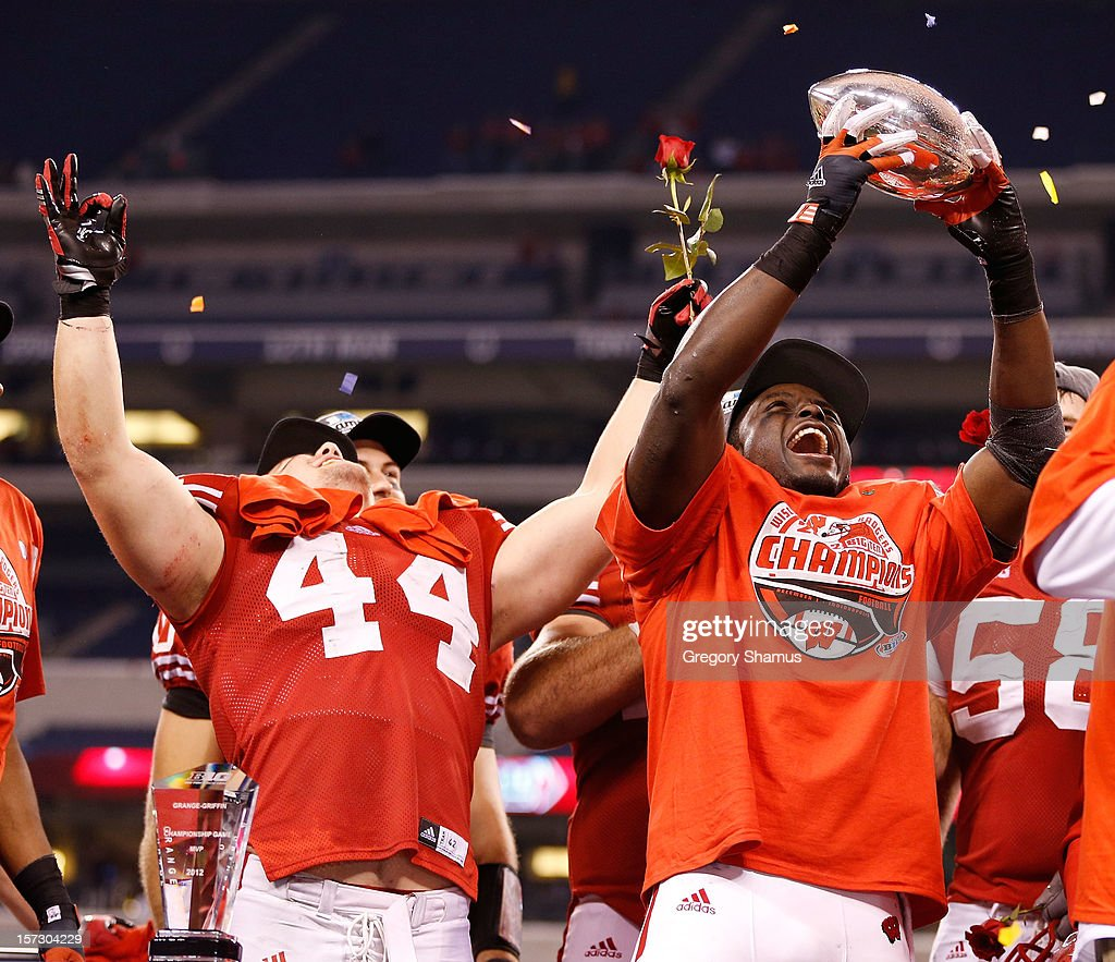 Montee Ball #28 of the Wisconsin Badgers holds up the Stagg Championship Trophy with Chris Borland #44 celebrating next to him after beating the Nebraska Cornhuskers 70-31in the Big 10 Conference Championship Game at Lucas Oil Stadium on December 1, 2012 in Indianapolis, Indiana.