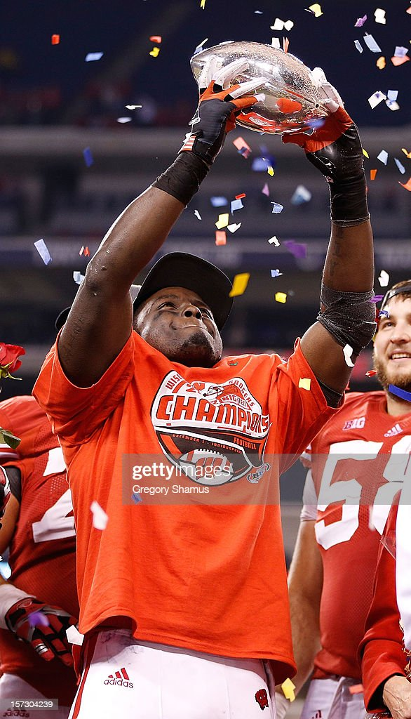 Montee Ball #28 of the Wisconsin Badgers holds up the Stagg Championship Trophy after beating the Nebraska Cornhuskers 70-31in the Big 10 Conference Championship Game at Lucas Oil Stadium on December 1, 2012 in Indianapolis, Indiana.