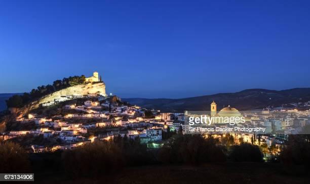 Montefrio skyline illuminated at late dusk in Granada, Andalusia, Spain