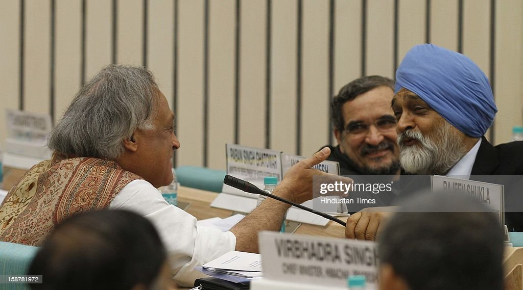 Montek Singh Ahluwalia Deputy chairman of Planning Commission with Jairam Ramesh Union Minister for Rural Development at the Sixth Meeting of the National Water Resources Council, at Vigyan Bhawan on December 28, 2012 in New Delhi, India.