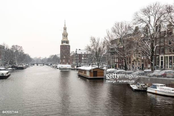 Montelbaanstoren in Amsterdam on day with snow